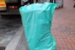 Bin covered in green bag in Purley High Street